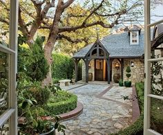 """From the entrance, the Tudor-style residence, which once belonged to composer Henry Mancini, """"looks like a small cottage,"""" says Alpert. """"But it unfolds in many directions. Cottage Design, Cottage Style, House Design, Rustic Exterior, Exterior Design, Exterior Paint, Architectural Digest, Kelsey Grammer, Tudor Style Homes"""
