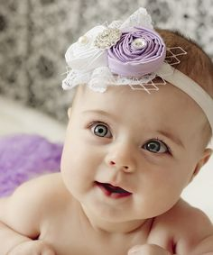 This precious set's unfinished edges turn shabby into sweet! Soft and stretchy, the ruffle diaper cover and matching headband adorned with gems and roses are sure to keep little munchkins comfy while melting the hearts of all who see them.Includes diaper cover and headbandHeadband: 14'' circumference100% cotton