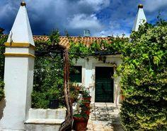 On the road series. Greece  #greece #roadtrip #corfu #island #monastery #paleokastritsa #house #vine #flowers #door #thelonelytraveler#travelphotography #travel #vacation #traveladventures #ontheroad #audia4 #bluesky .