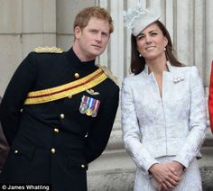 Prince Harry and Kate share an observation during the flypast...