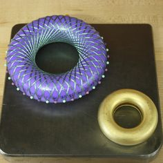"""Model and smithed torus for """"The Mathematical Fingerprint of God"""" brooch."""