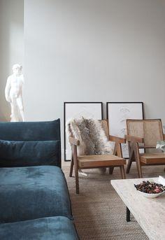 blue velvet sofa, midcentury chairs, grey walls