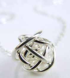 Love Knot Necklace. Designed to remind us of all the twists & turns we take in our lives:)