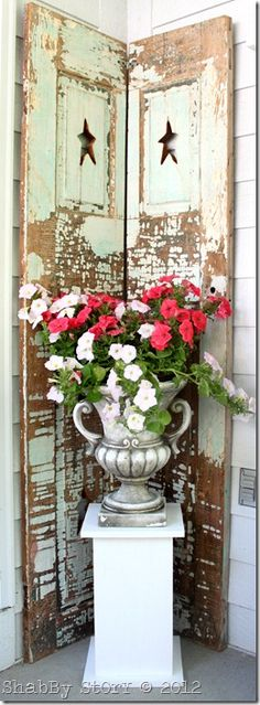 chippy old door and urn to brighten up a corner of the porch