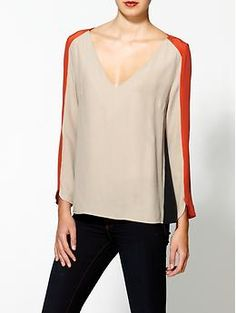 "Aryn K. Silk Trim Colorblock Blouse  Deep v-neckline  Contrast silk back  Long sleeves  Back keyhole detail    Model is 5'9, wearing a size S  Body length: 23 "", sleeve length: 24"""
