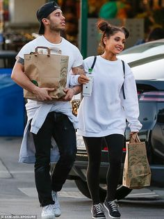 Cute couple: Ariana had her hair styled in buns for the trip to the supermarket...