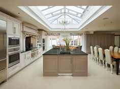 Moneyhill Interiors created A luxurious bespoke traditional yet contemporary Kitchen/ Dining space for a family home in Hertfordshire, with the large island sitting perfectly under the vast roof lantern vaulted extension. Overmantle above the Wolf range ,Sub Zero Refrigeration & a wall of Bi- Fold Larders complete the interior.