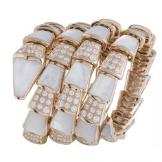 Shop for Bvlgari Serpenti Rose Gold Diamond and Mother of Pearl Wide Spiral Bracelet. Get free delivery On EVERYTHING* Overstock - Your Online Jewelry Destination! 18k Rose Gold, 18k Gold, Bvlgari Bracelet, Bvlgari Serpenti, Bulgari Jewelry, Luxury Jewelry Brands, Name Jewelry, Spiral, Jewelry Watches