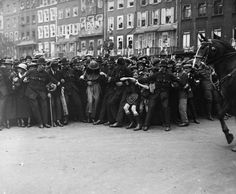 July 1919, Police hold back spectators at a parade in London.