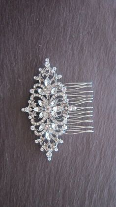 Quality, stunning hair comb  Adorned with bright, clear crystals  Pretty Art Deco inspired crystal bridal hair comb.  Vintage on-trend style  Crystal element measures 5cm x 9cm set on a silvertone back and comb.
