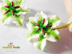 """Earrings """"green and white lily"""" of polymer clay. wow, lots to learn."""