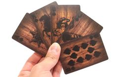 The next game of poker will be smok'n hot!  A deck of cards with wooden fence background with burned graphics to heat up the next game with your friends.    Material: Paper