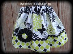 Girls Twirl Skirt Custom..Butterfly by BabyLiciousBoutiqu on Etsy, $16.99. love the flower and rickrack detail