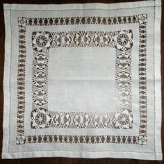 Vintage white pulled thread work table linen.