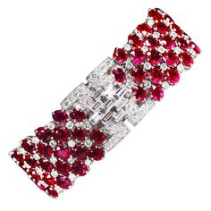 Highly flexible bracelet set with 81 rubies weighing approximately 60 carats, and 231 round and baguette diamonds weighing approximately 13 carats.