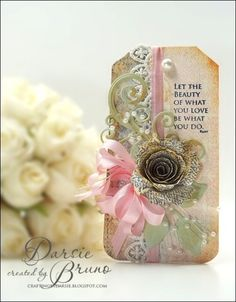 a pretty tag created using @Spellbinders Spiral Blossom One with JustRite Papercraft Vintage Wallpaper background and a stamp by Becca Feeken