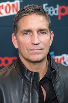Actor Jim Caviezel poses in the press room for the 'Person of Interest' panel during ComicCon Day 4 at The Jacob K Javits Convention Center on...