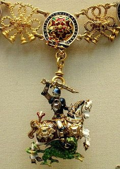 Enamelled gold St. George and the dragon with diamond 17th c England. This is known as the Great George (as opposed to the Lesser George), and it hangs from the Collar of the Order of the Garter.
