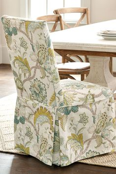 Want an easy update for your dining room? Try a patterned slipcover - you can switch it out if you ever want to change it up!