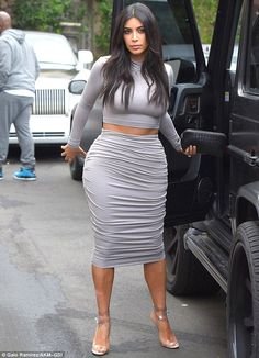Her favourite look: Kim Kardashian wore her go-to crop top and pencil skirt combination on...