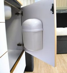 This small Cabinet Mount Trash Can saves space and stays in place. The mounted garbage can is small enough to fit inside most cabinets and is a great way to keep your space looking clean. The slim trash can stays in place when traveling and is a great addition to most RVs and boats. It is easy to install with the hardw