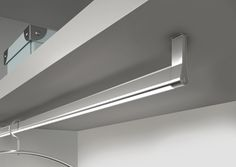 Goccia – a combined wardrobe hanging rod and illumination profile from DOMUS Line. Profile in aluminium, with a plastic strip to prevent coat hanger scratches.