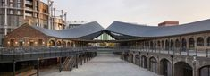 'coal drops yard', a major shopping district in london designed by heatherwick studio, opened the public on october Contemporary Architecture, Contemporary Design, Urban Architecture, Thomas Heatherwick, Republic City, Low Maintenance Landscaping, Garden Deco, Uk Images, Construction Process