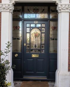 Decorative Edwardian front door painted dark blue with elegant stained glass. Traditional brass door furniture Decorative Edwardian front door painted dark blue with elegant stained glass. Black Front Doors, Wooden Front Doors, Painted Front Doors, Glass Front Door, Glass Doors, Georgian Doors, Victorian Front Doors, Georgian House, Front Door Porch