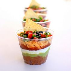 Cute little idea! 7 layer dip appetizer for guests. So everybody isn't huddled around one spot! I could also put my taco dip in this...I likey