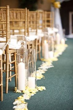 Romantic Candles Accent This Aisle Lined With White Chair