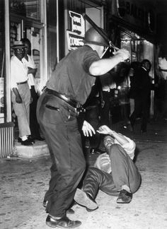 This photograph is capturing and recording history from the Civil Rights Movement. The picture is depicting police brutality. Is it up to the photographer to save the person from being beaten or for them to document the event so they may share the image and impact other people? http://photos.state.gov/galleries/usinfo-photo/39/civil_rights_07/