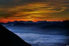 Fog covers the Inntal valley as the sunrise is seen from Hundskopf mountain in…