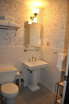 The wallpaper featured in the bathroom is by New Yorker cartoonist Saul Steinberg. The paper can be purchased through Schumacher