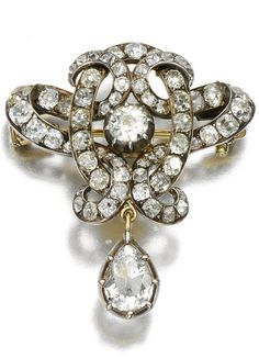An antique diamond brooch, late 19th century. Of openwork scroll design set…