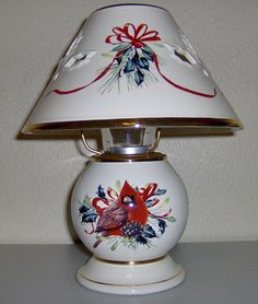 I think the Lenox Winter Greetings Candle Lamp is gorgeous..don't you?  I love the red bird and red ribbons.  Cardinals are one of my favorite birds and my Dad's too because he is a Cardinal baseball fan.
