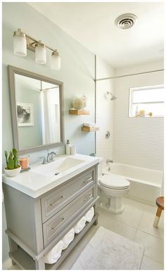 Small bathroom with grey vanity and soft colors Need ideas for a small bathroom renovation? Check out these 8 ways to make a small bathroom feel bigger from renovation expert Scott McGillivray Small Bathroom Renovations, Big Bathrooms, Bathroom Renos, Bathroom Interior, Modern Bathroom, Bathroom Remodeling, Bathroom Small, White Bathroom, Master Bathroom