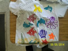 Ocean themed shirts using large stamps and paint!  So cute!