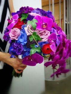 I love the cascading orchids! but there needs to be more fun added to this Bridal Bouquet #studioag #studioagdesign