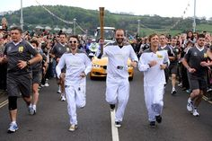 MUSE carrying the Olympic Torch. How cool is that! Cool is probably an understatement.