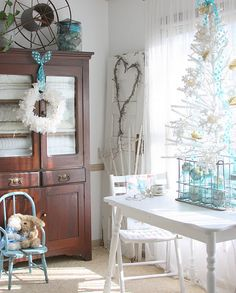 A simple beach Christmas look of white and aqua, with a beautiful stained cabinet to give everything a vintage look