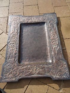 Stunning and large Arts & Crafts Scottish school copper tray measuring 59cms x 46cms with a deep well measuring 2cms. This has an incredibly intricate Celtic design of entwined leaves and roses and is superbly executed and has just been partially cleaned and is offered in excellent original