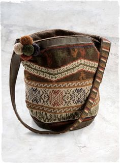 Yucay Bag     Densely hand-crocheted with decorative Andean motifs, this stunning bag is detailed with leather trim, a long shoulder strap and a zip-top closure. Fully lined with an inside pocket. In pima (67%), baby alpaca (23%), wool (9%), silk (1%).