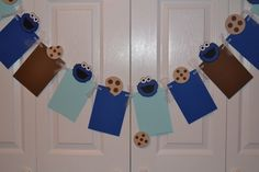 Cookie Monster Inspired Photo Banner - Holds 12 Photos - Detachable Favor Clips - Birthday / First Birthday / Party by SimplyBlessedHome on Etsy https://www.etsy.com/listing/180793687/cookie-monster-inspired-photo-banner