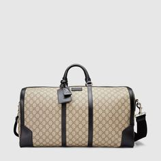 Shop the GG Supreme duffle by Gucci. Large duffle in GG Supreme canvas with leather trims and a durable nylon strap. Cheap Handbags, Hobo Handbags, Gucci Handbags, Luxury Handbags, Purses And Handbags, Gucci Bags, Gucci Men, Designer Handbags, Gucci Gucci