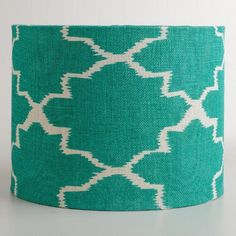 With a striking texture reminiscent of burlap, our cotton and jute drum shade features an exclusive geometric design against a saturated turquoise ground. Match this versatile shade with any of our table lamp bases, or convert it into a chic hanging pendant with one of our electrical cord kits.