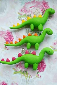 Bet I could make these! However, here is where you can order them; Cute Green Fimo / Polymer Clay Dinosaur Necklace - Pink, Yellow or Orange Spikes Choose One. via Etsy. Polymer Clay Kunst, Polymer Clay Projects, Polymer Clay Charms, Polymer Clay Disney, Clay Crafts For Kids, Kids Clay, Clay Figures, Fondant Figures, Clay Dragon