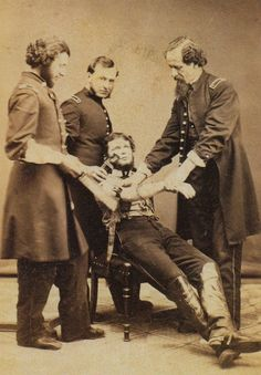 ca. 1864, [U.S. Army surgeon, Dr. S. Baird Wolf, about to amputate an arm]    via Respiratory Diseases: a Photographic History 1845-1870, The Pioneer Era, Stanley B. M.D. Burns
