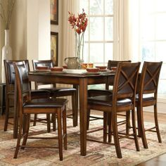 """HomeHills Chocolate Brown Five Piece Counter Height Dining Set by HomeHills. $1160.95. 53.5""""""""W x 53.5""""""""H x 39.5""""""""D. Finish: Chocolate Brown. -Entertaining has never been easier with this 5 piece counter height dining set. The table extends from 36"""" to 54"""" to accommodate last minute guests painlessly. Table and chairs feature a rustic distressed oak finish for a look that transcends time. Chair seats and backs feature rich chocolate brown upholstery with comfortable padd..."""