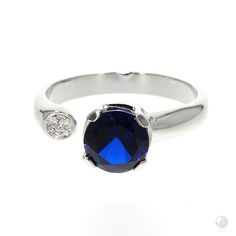"""FERI - Blueberry Delight - Ring - Exclusive FERI 950 Siledium silver - Exclusive dual natural rhodium and palladium plating - Set with AAA white cubic zirconia and blue cubic zirconia - Dimension: 8mm (0.3"""") - Wt. 4.67/gm - Size RD. 7.5mm Invest with confidence in FERI Designer Lines. Designer Lines. Claim your Free $100 Gift check www.gwtcorp.com/ghem or email fashionforghem.com for big discount"""