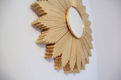 "Wood Shim Starburst    What i used    192 – 8"" wood shims (14 packs)    7"" wood embroidery hoop    7"" craft mirror    Leftover piece of Masonite board    hot glue gun    Rust-oleum Metallic Gold Spray Paint"